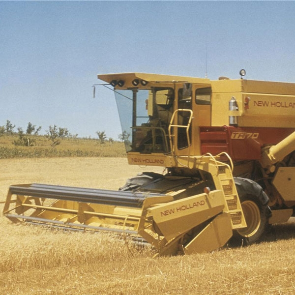 first-twin-rotor-combine-new-holland-agriculture-history-1974